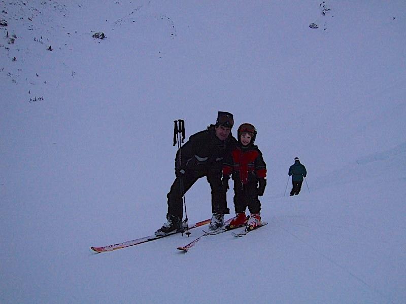 Larry, teaching his son Mitchell to ski in Whistler.
